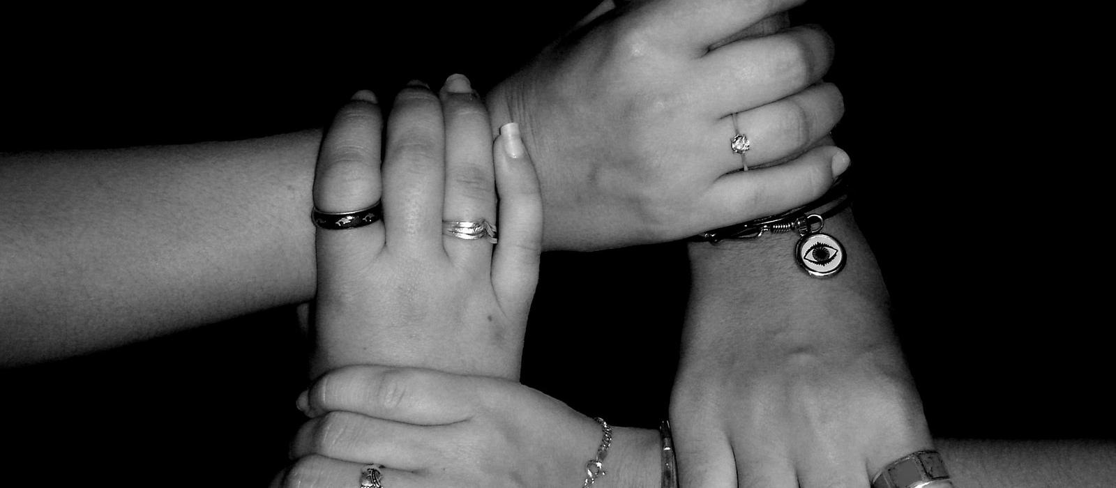 Support group, hands joined