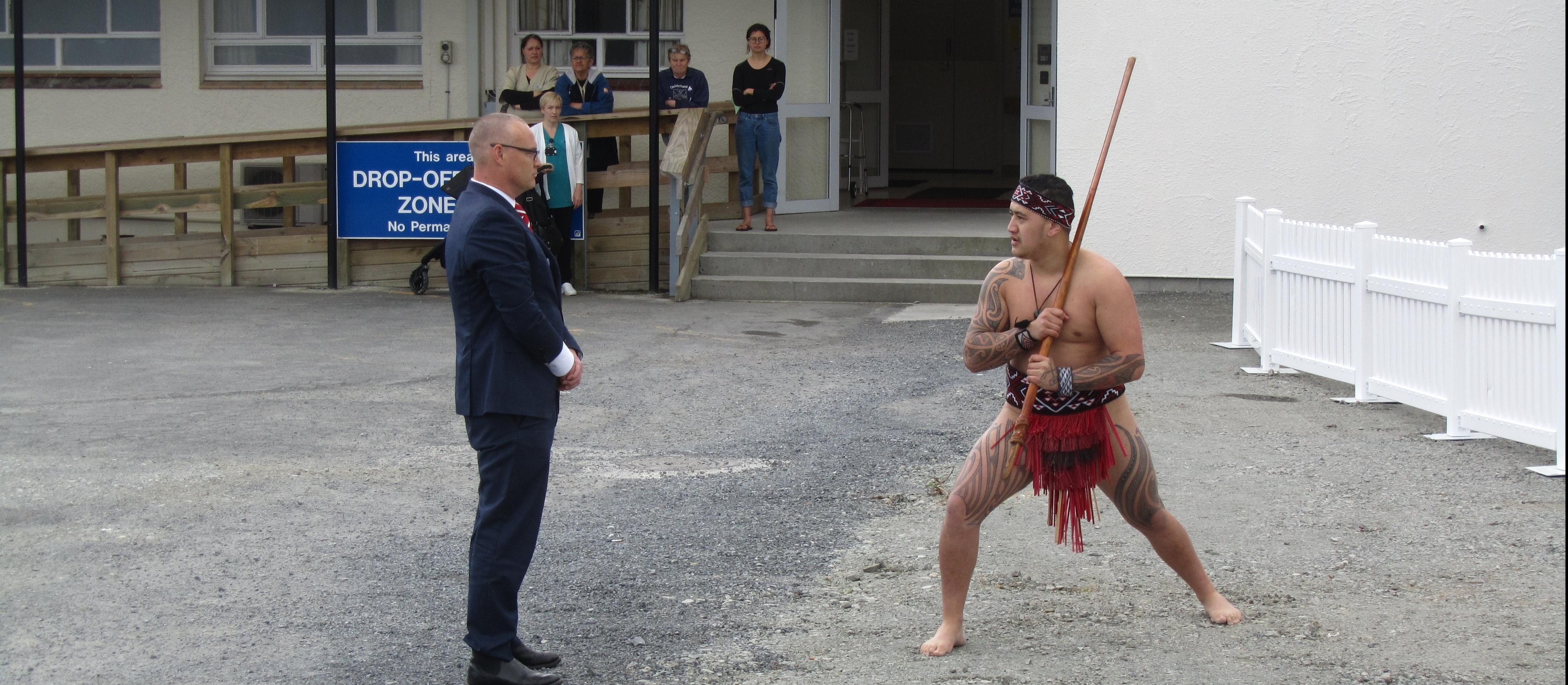 Health minister David Clark accepts the wero (challenge) during the pōwhiri at Bay of Islands Hospital