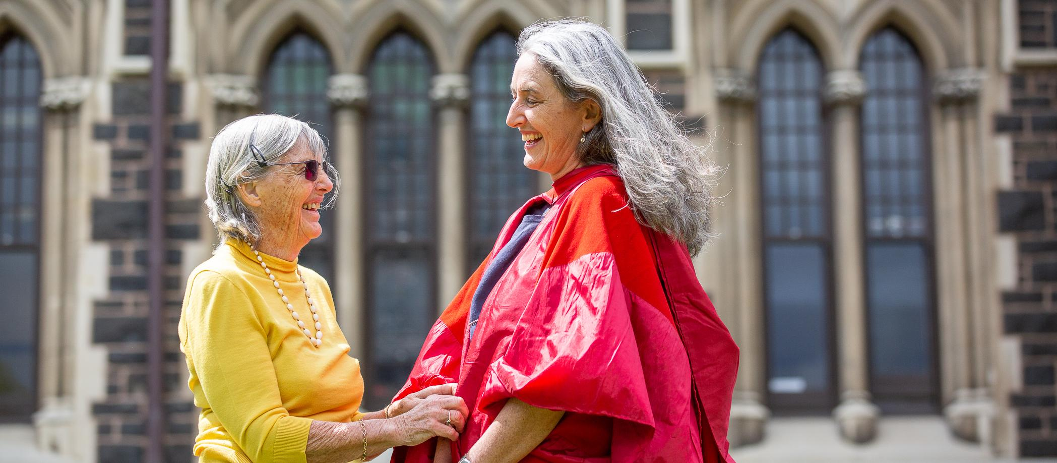 Edith Atmore (left) with daughter Dr Carol Atmore wearing great-grandmother's gown for PhD graduation 2019