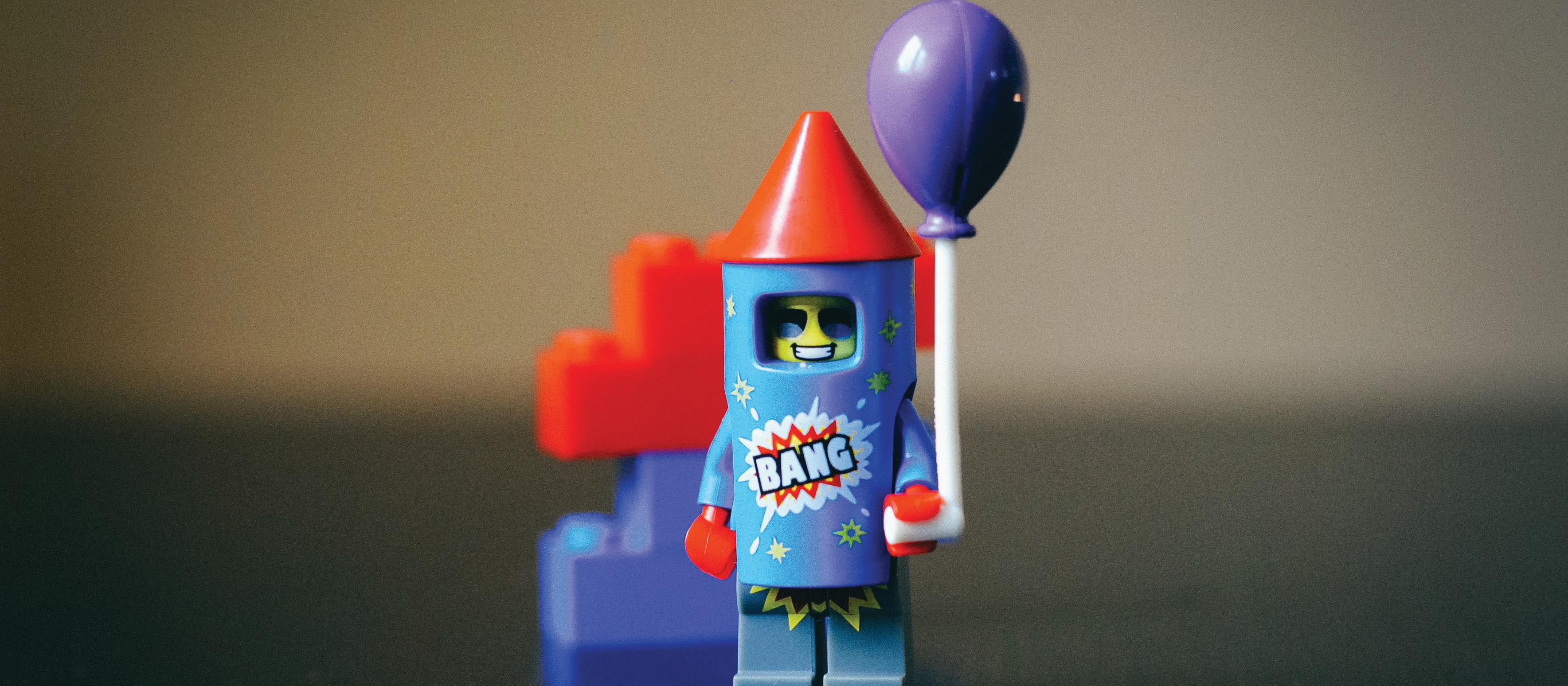 Lego man, balloon, bang