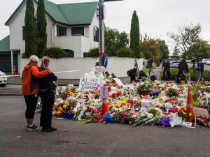 Women leaving flowers for Christchurch mosque shootings victims near the Al Noor Mosque