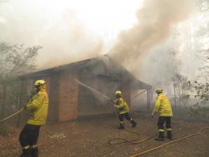 Fire fighters put out bushfire in NSW